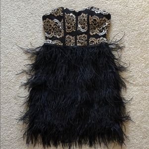 Strapless gold black and feather dress